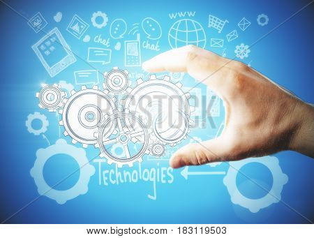 Creative image of male hand drawing abstract drawn cogwheels. Technologies concept