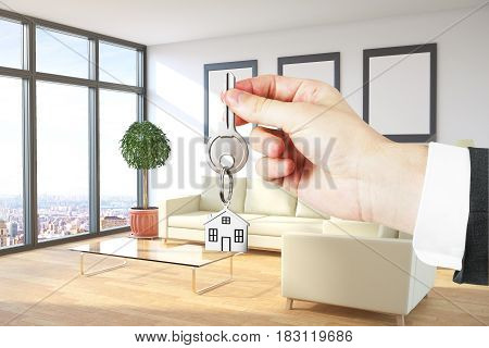 Businessman's hand holding key in living room interior with city view furniture. Real estate concept. 3D Rendering
