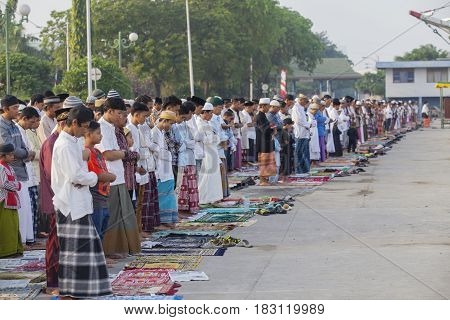 JAKARTA Indonesia. April 18 2017: Asian Muslim celebrates Eid Mubarak while praying to Allah outdoors