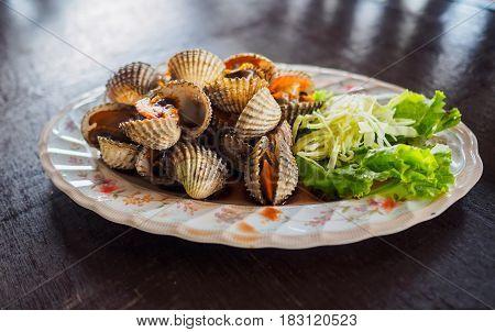 Scald scallops cockles shell as a starter menu.