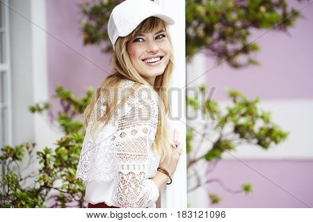 Pretty young woman looking away with cap