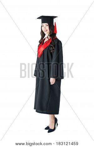 Full Length View Of Beautiful Young Brunette Woman In Academic Gown And Mortarboard