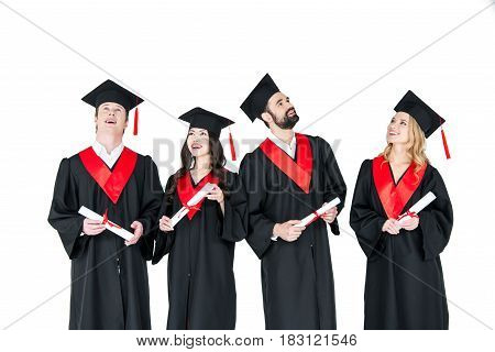 Group Of Young Men And Women In Graduation Gowns And Mortarboards Holding Diplomas