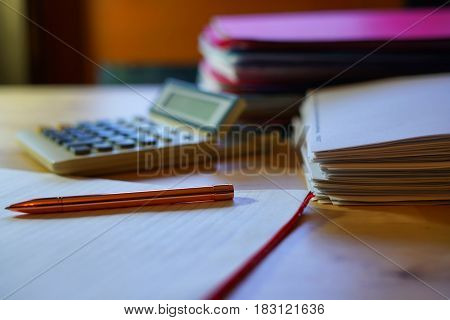 Empty Accountants Desk, With Calculator And Stacks Of Paperwork