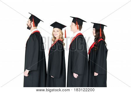 Smiling Students In Graduation Caps Standing In A Row Isolated On White
