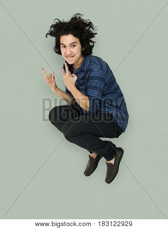 Young Adult Man Jumping Studio Portrait