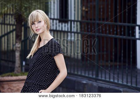 Beautiful woman in spotty dress - streetfashion