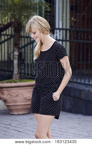 Young blond woman in spotty outfit -streetfashion