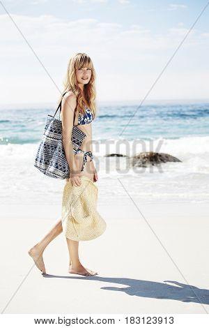 Blond cool beach babe in bikini portrait