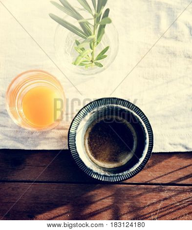 Fresh Orange Juice and Coffee with White Cloth