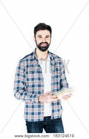 Bearded Student Holding Copybooks And Looking At Camera Isolated On White