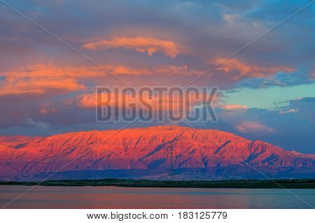 Sunset at the Dead Sea overlooking the mountains of Jordan