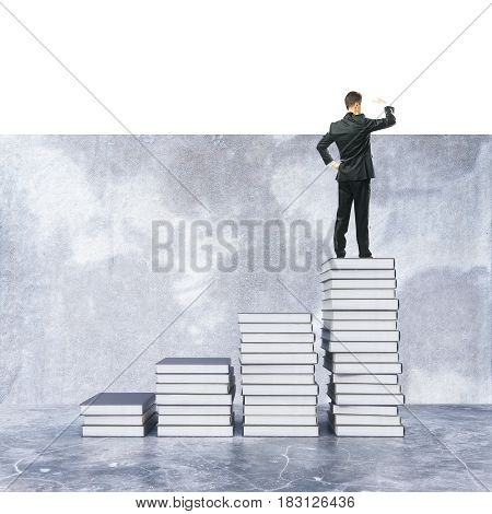 Young businessman on top of creative book ladder looking into the distance. Knowledge concept. 3D Rendering
