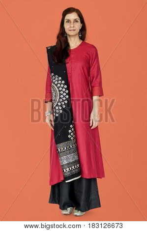 Indian woman standing with traditional suit