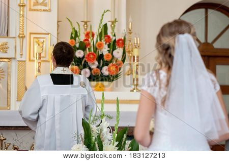 The pastor and the bride in the church.