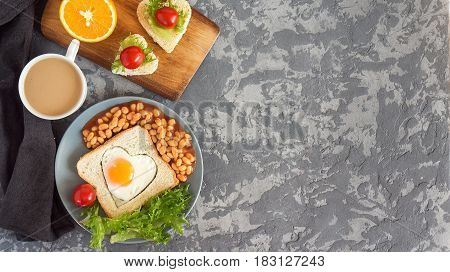 Full English Breakfast With Fried Eggs, Beans, Toasts, Salad, Tomatoes On Gray Background. Copy Spac
