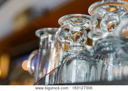 Closeup of emplty glasses with handles in restaurant