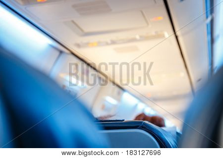Interior Of Airplane With Passengers On Seats, Shallow Dof