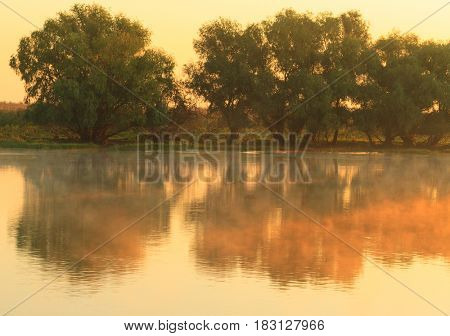 View morning sunrise and fog on Danube river, Sulina channel