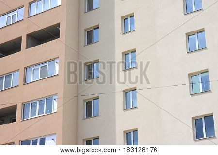 Facade of beautiful multi-storey modern building with windows