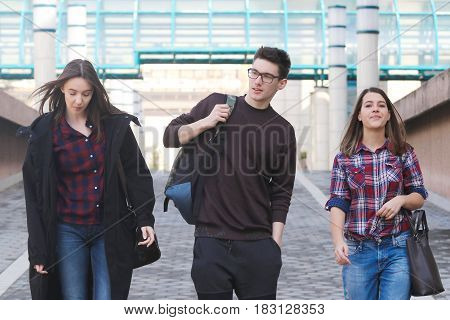 Three High School students walking in the campus