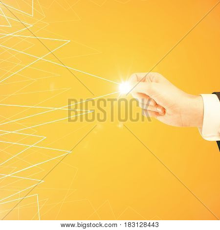 Side view and close up of male hand dragging abstract drawn triangular pattern on orange background