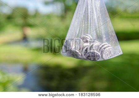 Bag with wedding day inbound souvenir coins.