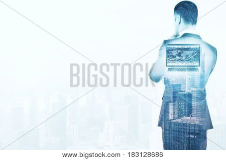 Back view of thoughtful young businessman on abstract city background with copy space. Double exposure. Tomorrow concept