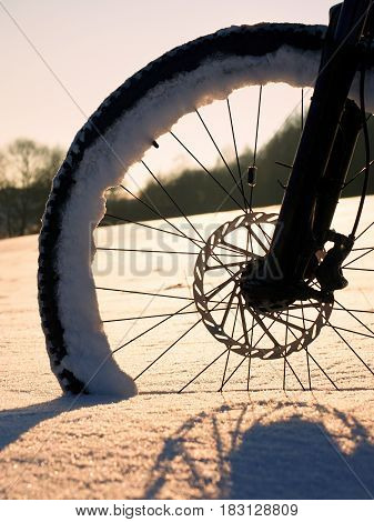 The Front Wheel Of Mountain Bike Stay In Powder Snow, Deep Snowdrift.