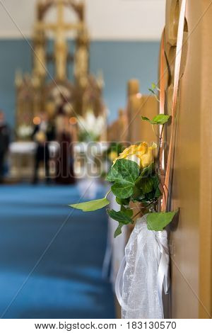 Church wedding decoration with flowers and ears.