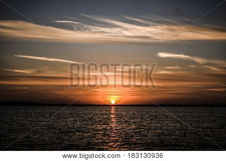 Beautyful sunset with clouds on the sky by the bea Poland.