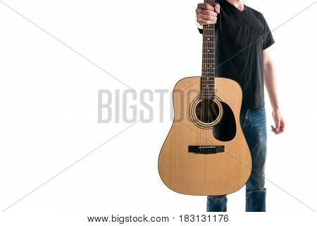 Guitarist In Jeans And A Black T-shirt, Stretches An Acoustic Guitar, On The Right Side Of The Frame