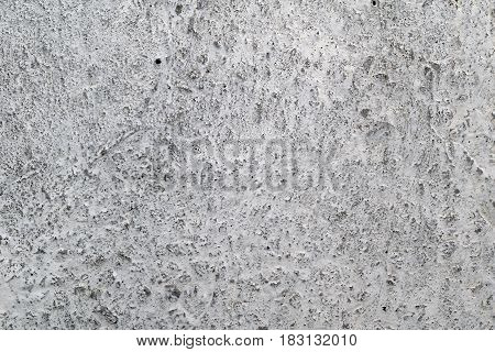 Old gray and white concrete wall with abrasion background.