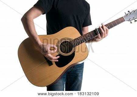 Guitarist In Jeans And A Black T-shirt, Playing An Acoustic Guitar With A Slider, On The Left Side O