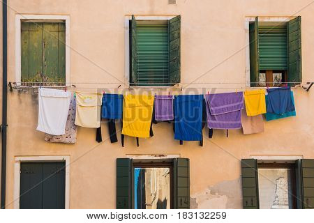 Laundry hanging out of a typical Venetian facade Italy