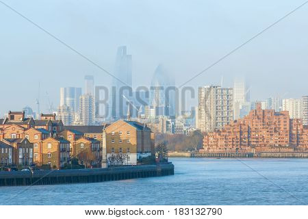 Hazy view of City of London seen from Canary Wharf