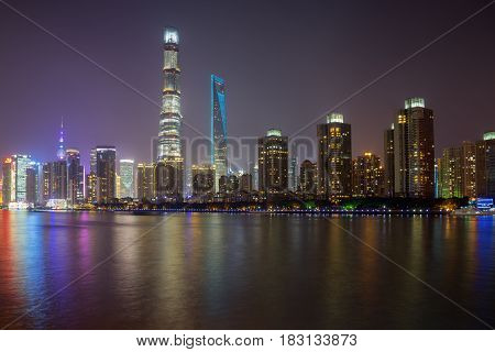 SHANGHAI China. April 18 2017: Beautiful landscape of Lujiazui financial center with colorful lights at night in Shanghai China