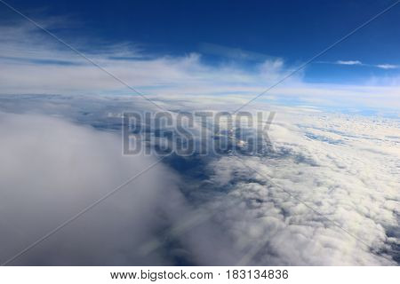 Clouds seen from the plane nature backgroun blue