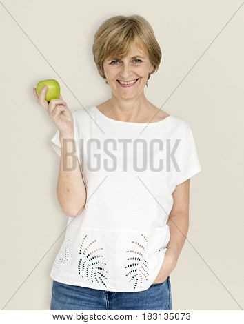 Mature Caucasian Woman Smiling Holding Apple
