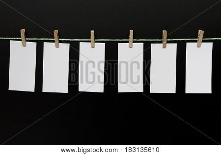 Six pieces of paper on dark background