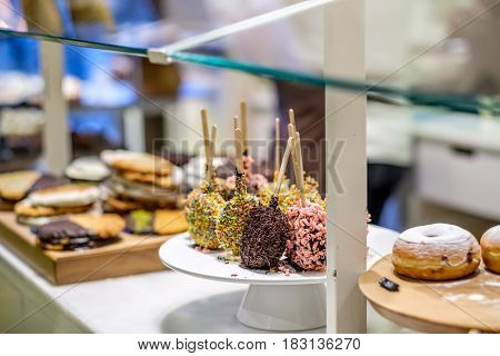 Donuts in assortment at confectionery store