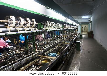 SUZHOU China. April 18 2017: People in spinning machine of silkworm cocoons at Suzhou China