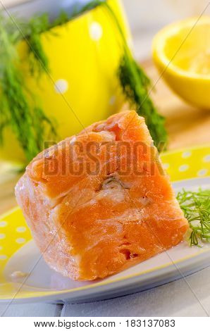 Slices of raw red fish in a briquette for cooking