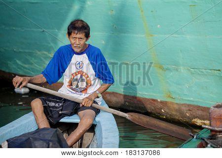 JAKARTA Indonesia. April 18 2017: old man rowing a passenger boat in the Sunda Kelapa harbor