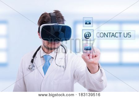 Doctor With Vr Glasses Touching Contact Us Sign