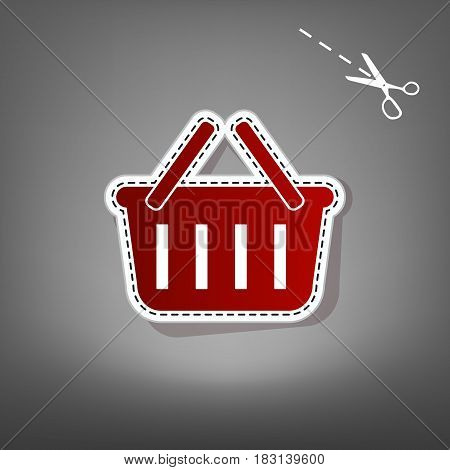 Shopping basket sign. Vector. Red icon with for applique from paper with shadow on gray background with scissors.