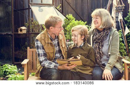 Grandparents Teaching Reading Book Garden