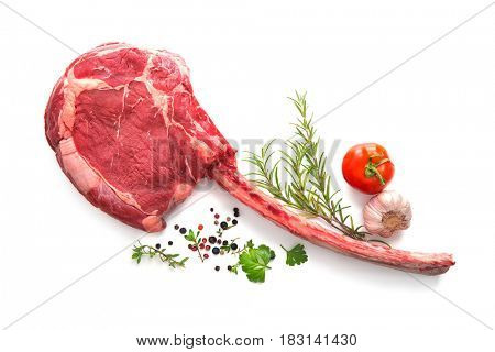 Raw dry aged tomahawk steak isolated on white