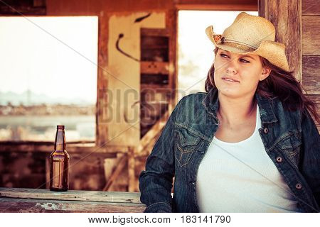 Beautiful country girl with beer bottle