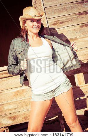 Beautiful country fashion girl wearing shorts